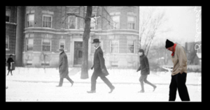 Image of Alderman Joseph Badenoch, viewed from the side, walking along a residential street covered in snow in Chicago, Illinois. Picture of Joe Gregorio super-imposed.