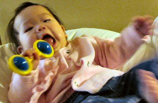 Caden playing with a rattle.