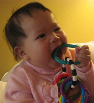 Caden playing with a teething ring.